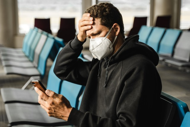 stock photo travel airport telephone man temperature mask airport terminal pandemic coronavirus dedecfed a001 415e a63a 6d3a115c592a